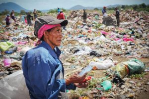 Nic 2015 woman at trash dump
